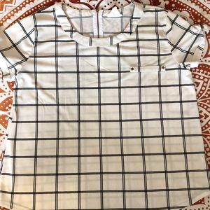 Black lines, white squares, zipper on the back